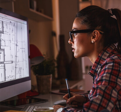 girl architect working, staring at desktop screen
